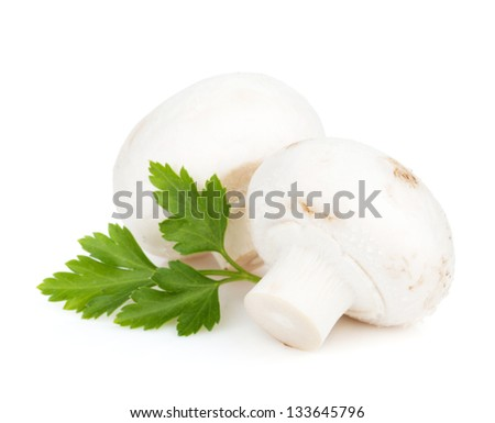 Champignon mushrooms with herbs. Isolated on white background
