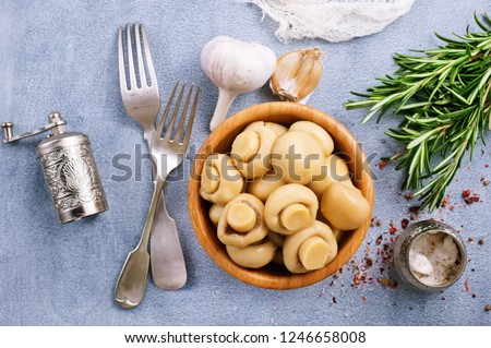 champignons marinated,pickled mushrooms with spice in bowl #1246658008