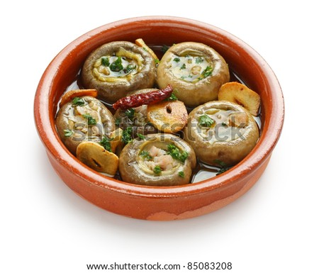 champinones al ajillo , garlic mushrooms , spanish tapas dish - stock photo