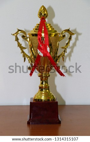champion golden trophy on wood table with copy space, copy space ready for your design #1314315107