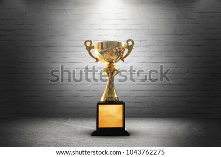 Champion golden trophy on wooden table background. copy space. #1043762275