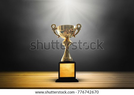 Champion golden trophy on wooden table background. copy space. #776742670