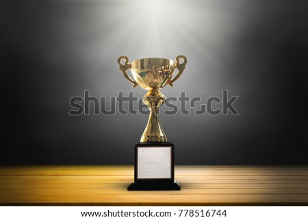 Champion golden trophy on wooden table background. copy space. #778516744