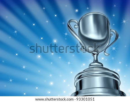 Champion silver cup award in a dynamic forced perspective camera angle and a blue star burst glowing sparkles background as success in sports and  in a competition as a winner in business.