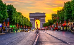 Champs-Elysees and Arc de Triomphe at night in Paris, France. Architecture and landmarks of Paris. Postcard of Paris