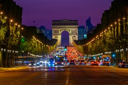Champs-Elysees and Arc de Triomphe at night in Paris, France. Night cityscape of Paris. Architecture and landmarks of Paris.