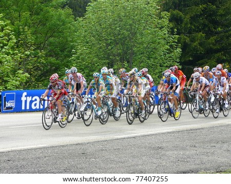 """CHAMROUSSE, FRANCE - JUN 11: Professional racing cyclists ride UCI WORLD TOUR """" CRITERIUM DU DAUPHINE LIBERE"""" on June 11, 2010 in Chamrousse pass, Isere, France."""