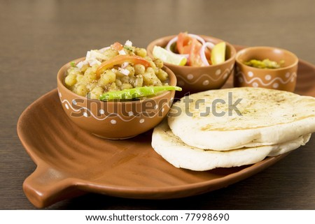 chana masala  or chickpea curry with kulcha or bread, indian dish