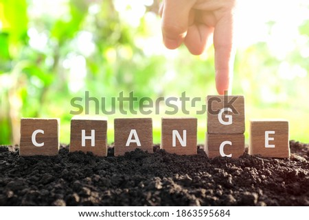 Chance to change, new opportunity, optimism and career growth concept. Male hand changing or flipping word chance to change wooden blocks dice in natural background.