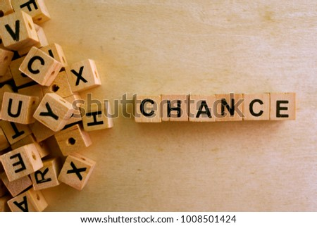 Chance  word cube on wood background ,English language learning concept #1008501424