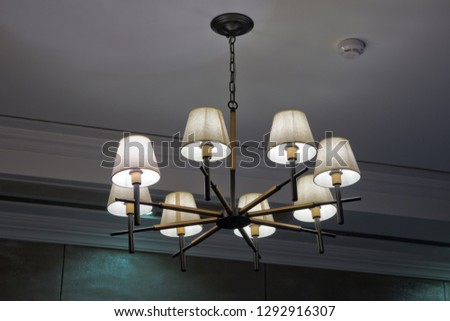 Chandelier on the ceiling .Chandelier in the Italian style. Vintage chandelier. Retro ceiling lamp . Beautiful expensive royal chandelier hanging at the ceiling in the dark room - Image