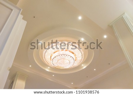 chandelier Palace Interior architecture background. Luxury expensive chandelier hanging under ceiling in palace. Luxurious crystal chandelier found in a rich manor house.
