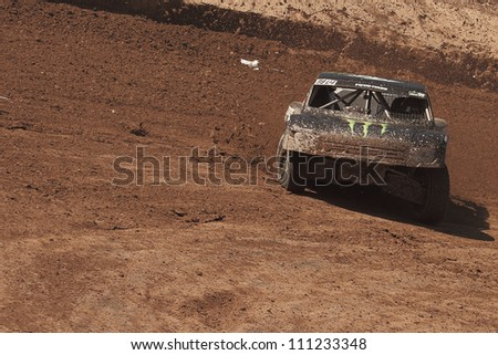 CHANDLER, AZ - MAR 30: Kyle LeDuc (99) at speed in Pro 4 Unlimited Lucas Oil Off Road Series racing qualifying on March 30, 2012 at Firebird International Raceway in Chandler, AZ.
