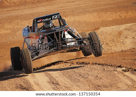 CHANDLER, AZ - OCT 26: Steven Greinke (23) at speed in Pro Buggy Lucas Oil Off Road Series racing during a qualifying session on October 26, 2012 at Firebird International Raceway in Chandler, AZ.