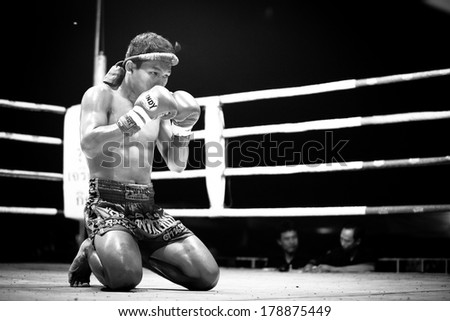 CHANG THAILAND FEB 22 2013 Unidentified Muaythai fighter in ring during match black and white series For many Thai men Muaythai only way to break out of poverty per battle pay to 7000 baht