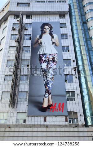 CHANGCHUN-CHINA-OCT. 11. H&M billboard on a flat. The Swedish multinational retail-clothing company opened its 100th Chinese outlet on Sept. 20, 2012 in Nanning. Changchun, Oct. 11, 2012.