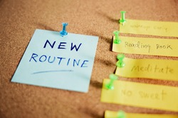 Change Concept. Managing New Routine from Old to New Habits by Sticky Note on Cork Board. Closeup shot