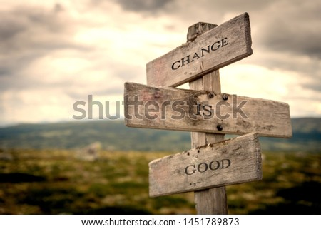 Change is good quote on wooden signpost in nature with moody background. Motivational, move on, changes, choice, choices concept. #1451789873
