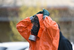 Change of rescuers comes out a zone of infection and is exposed to decontamination and cleaning. Doctors and Firefighters with anti-contamination suits fight the Corona Virus 2019-Ncov epidemy.