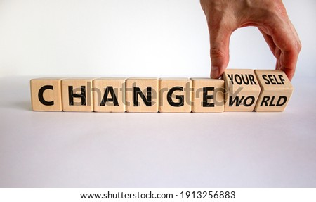 Change world or yourself symbol. Businessman turns wooden cubes and changes words 'change world' to 'change yourself'. Beautiful white background, copy space. Business and change yourself concept.