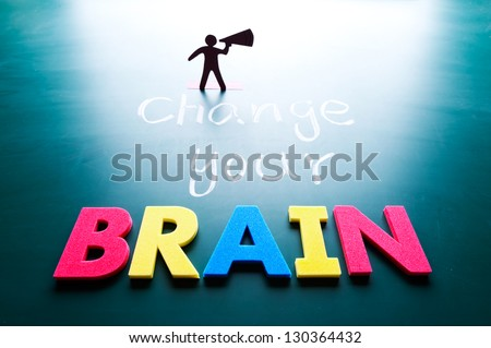 Change your brain concept, man and words on blackboard