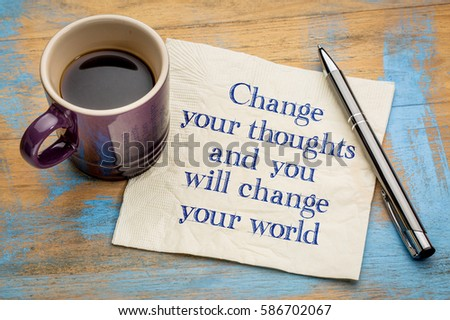 Change your thoughts and you will change your world - handwriting on a napkin with a cup of espresso coffee #586702067