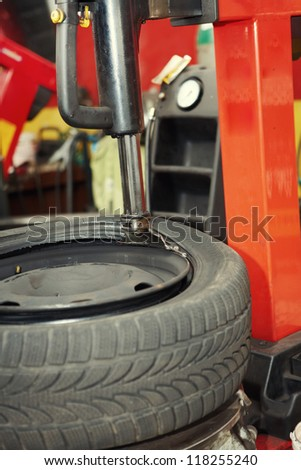Changing a tire in auto repair shop
