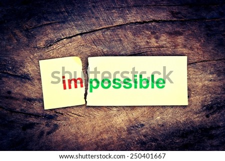Changing the word impossible transformed into possible. Conceptual of successfully overcoming problems. #250401667