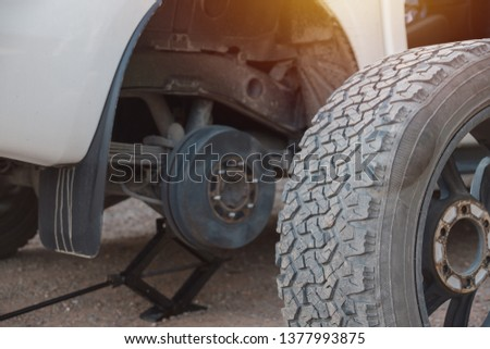 Changing tire with tire damage #1377993875