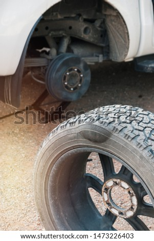 Changing tire with tire damage