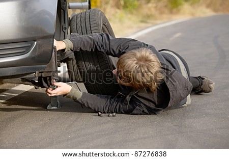 Changing wheels on a car on the roadside