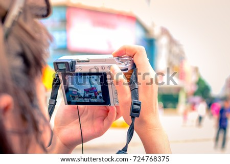 CHANGSHA,CHINA 29 august 2017 - A tourism is photographing at Huangxing road walking street #724768375