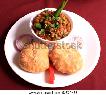channa bhatura with salad a very popular south asian breakfast or lunch
