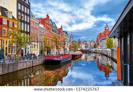 Channel in Amsterdam Netherlands houses river Amstel landmark old european city spring landscape. #1374225767