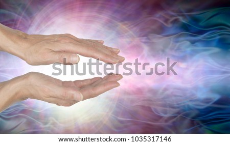 Channeling Vortex healing energy  - female hands held parallel with a white vortex energy formation and pink blue ethereal energy field  background