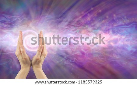 Channelling Vortex healing energy  - female hands facing upwards with a white spiralling vortex energy formation and pink blue purple misty ethereal energy field background with copy space