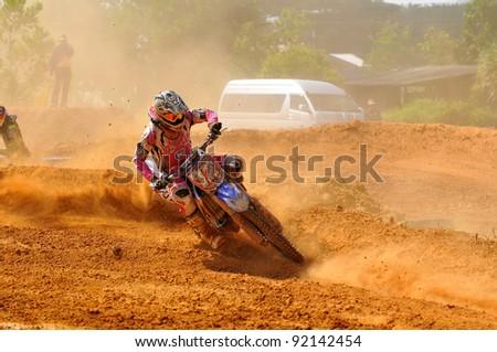 CHANTABURI, THAILAND - NOV 20: An unidentified rider participates in the final round of the 2011 Thailand motocross championship on November 20, 2011 in Chantaburi, Thailand.