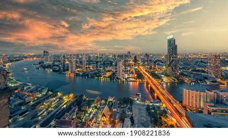 Chao Phraya river with sun raise and modern building ,Landscape of River in Bangkok city