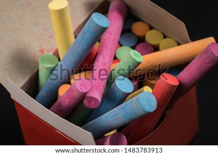 Chaotic colorful chalk in a chalk box