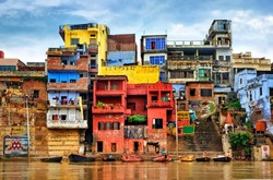 Chaotic colorful houses on the banks of river Ganges, Varanasi, India