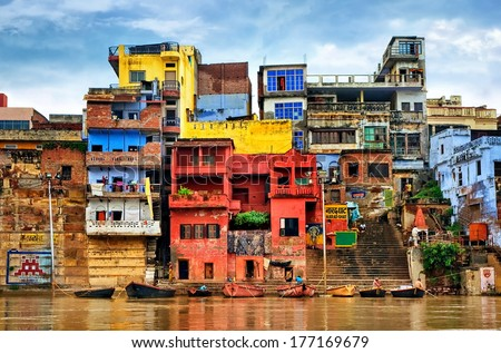 Chaotic colorful houses on the banks of river Ganges, Varanasi, India #177169679