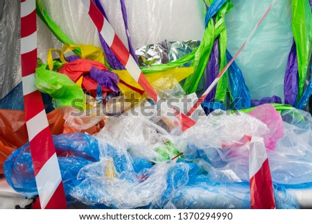 Chaotic consumption. Dirty bright bunch of bags and packages with striped line all around representing sins of population #1370294990
