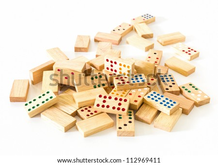 Chaotic heap of wooden domino on white background