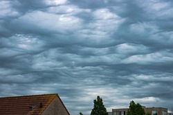 Chaotic sky with bubble clouds. Scientific name of the clouds is altocumulus undulatus asperitas.