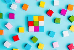 Chaotically disorganized colored cubes and ordered. The concept of business model, structure, logical solution of the organization. order and chaos.