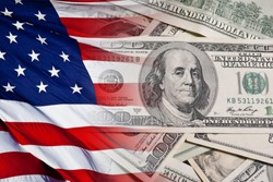 chaotically spread out money, bills of one hundred US dollars with flag of USA. Dollars with flag