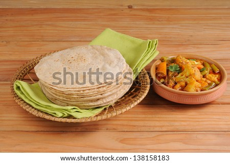 Chapati, also known as Indian flat bread, and  curry.