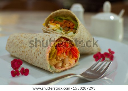 Chapati an Indian vegetarian food cuisine wrap salad without meat.  Selective focus.