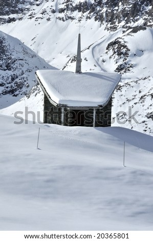 chapel in the snow with the Matterhorn behind