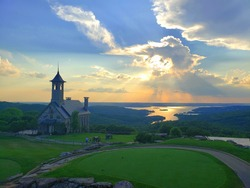 Chapel of the Ozarks in Branson, Missouri at Sunset with Table Rock Lake in the background